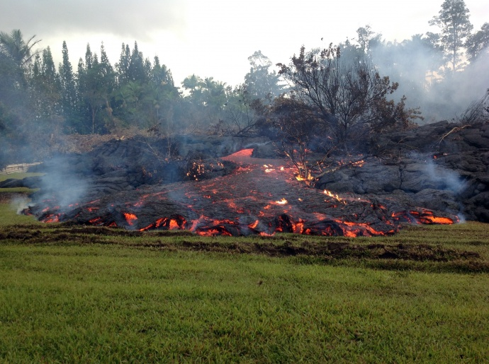 A breakout occurs from an inflated lobe of the June 27th lava flow on Sunday morning, November 2, 2014.  This is upslope of the stalled leading edge.  Photo courtesy USGS/ Hawaiian Volcano Observatory. File photo Nov. 2014.
