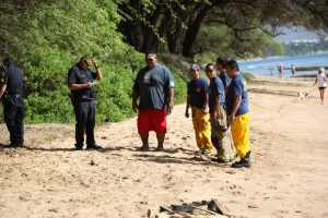 Photos By KEVIN J. OLSON. Suspected piece of unexploded ordnance in North Kihei.