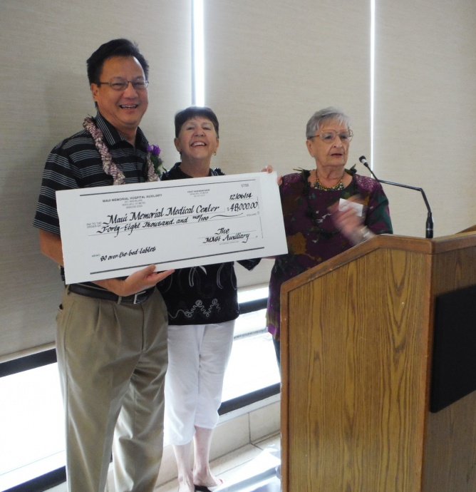 Auxiliary donates $48,000: Wes Lo, CEO of Maui Memorial Medical Center received a check for $48,000 from the Maui Memorial Hospital Auxiliary at a luncheon held earlier this month. Shown (left to right) are Lo, Linda Chong Auxiliary Treasurer and Amy Hanlon, President.