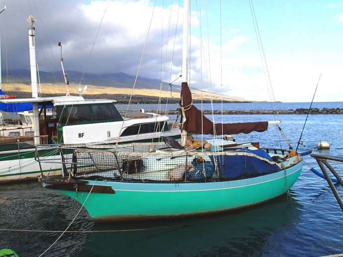 This picture is of 25-foot sailboat Malia whose owner placed a mayday call Nov. 27, 2014, saying his vessel was taking on water and in danger of sinking 46 miles west of Kailua-Kona. The Coast Guard has identified the mariner as 67-year-old Ron Ingraham and is believed to be the sole person aboard the sailing vessel which departed Kaunakakai Harbor, Molokaʻi, to Mānele Bay, Lānaʻi. (U.S. Coast Guard courtesy photo)