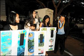 JUMPSmartMaui DC Fast Charger art contest winners Yasha Ronquillo, Tiffany Orite and Jun Cai display their winning designs to Mayor Alan Arakawa.  Photo by: Linn Nishikawa