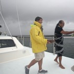 Captain John Patti and Kahu Lyons-Naone participate in the blessing of the PWF's Ocean Spirit vessel. Photo courtesy Pacific Whale Foundation.