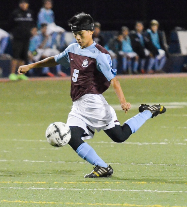 Baldwin's Caleb Soo Hoo  (5) gets ready to put his foot on the ball during second-half action Wednesday against Kamehameha Maui. Photo by Rodney S. Yap.