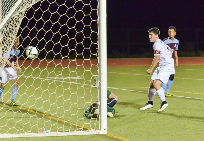 Kamehameha Maui's Micah Alo watches as Colton Cabanas' header bounces by Baldwin goal keeper Benjamin Wuthrich. Photo by Rodney S. Yap.