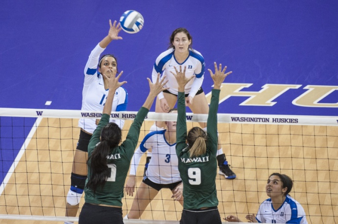 Rainbow Wahine blockers Olivia Magill (9) and Tai Manu-Olevao (10) go high above the net for an attempted block against Duke in Friday's NCAA first-round action from Seattle. Photo by Richard McEnery.