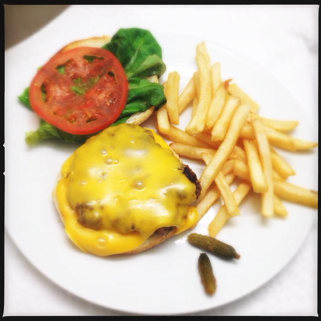 Tante's Half Pound Angus Cheeseburger. Photo by Vanessa Wolf