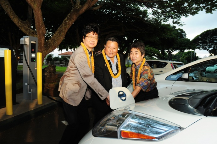 A blessing ceremony was held for the new EV charger stations located at the Kalana O Maui Building in Wailuku. Pictured from left: Dr. Hiroshi Kuniyoshi, executive director of NEDO; Mayor Alan Arakawa; and Takenori Haranaka, general manager of Hitachi's Energy Solution Systems Division. Photo courtesy Linn Nishikawa.