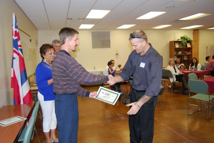 Graduate Johnathan Allen rec certificate from Loan Fund Magr John Flom- looking on Council member Stacy Crivello and BDC Director Craig Swift