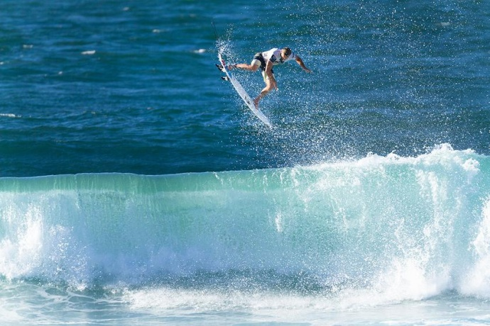 Maui's Dusty Payne won the Reef Hawaiian Pro in mid-November with aerial moves like the one here en route to a near-perfect 19.64 in the event final. Photo by ASP/ Kelly Cestari.