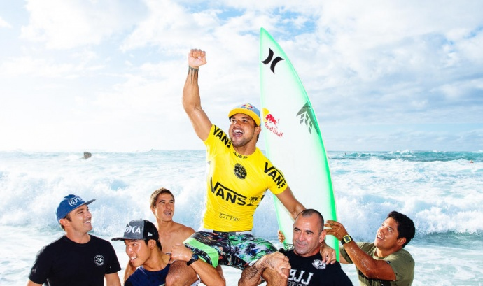 Tahiti's Michel Bourez is carried off Sunset Beach after winning the Vans World Cup of Surfing on Oahu's North Shore Friday. Photo by ASP / Ed Sloane.