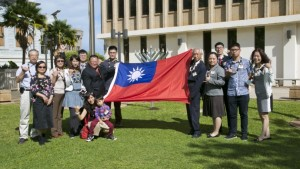 Mayor Alan Arakawa and Pingtung Sister County Chairmen Alexander C.H. Chang and Elizabeth H.T. Hsu hold a Taiwan flag on the front lawn of the County Building to mark the occasion of the Pingtung delegation's visit. Photo courtesy County of Maui.