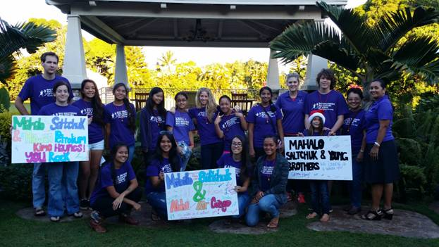 Members of Big Brothers Big Sisters hold mahalo signs, thanking Saltchuk for their generosity.  Photo courtesy BBBS.