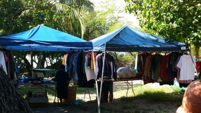 Donations were set up like this pop-up tent with clothing for families to look what they need/want and take. Photo by Brandee Carvalho.