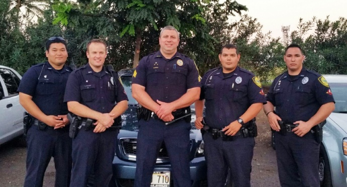 Pictured from left to right: Officer Alvin OTA, Officer Ryan EHLERS, Sergeant Nick KRAU, Officer Carl EGUIA, and Officer Rusty IOKIA.  Photo courtesy the Maui Police Department.