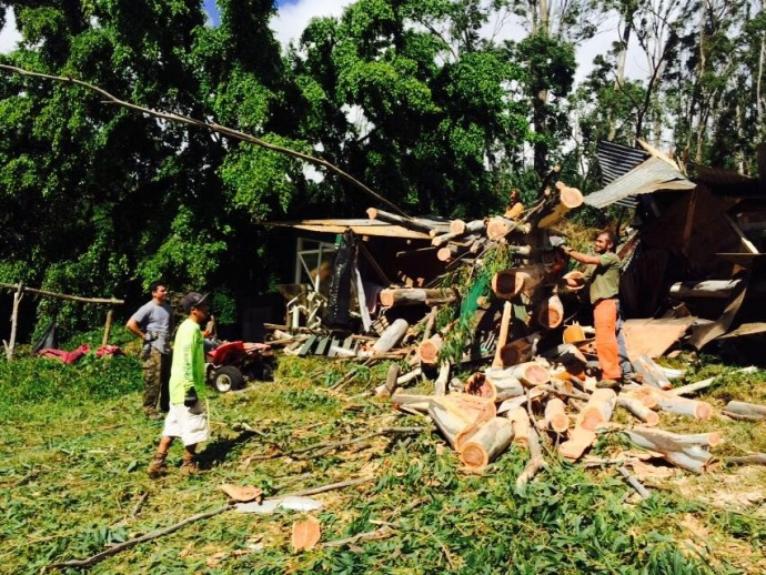 """""""Upper kanaio my sister cristines house split in half by a huge tree. Luckily she had another tree miss the house and she decided to get in her car when the big tree fell through her house and landed on the car she was taking refuge in."""" 1/3/14 - Image: Anne Nason"""