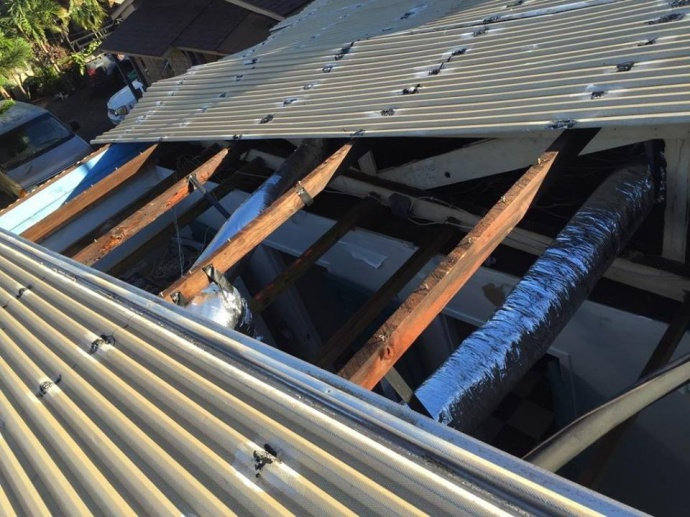 Storm roof damage near Main Street in Wailuku. 20 foot metal roof panel flew off and landed in neighbor's yard. 1/3/15 - Image: Jonathan Starr