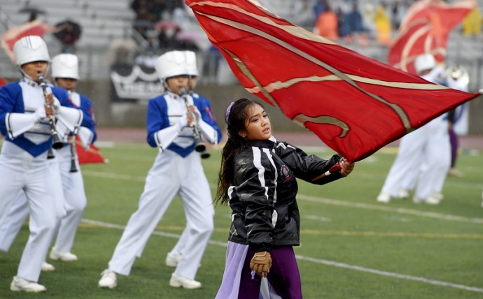 The Maui High School Saber Marching Band & Color Guard performs in the rain and cold Tuesday at Bandfest, a pre-Rose Parade event featuring every marching band that will appear in the New Year's Day Tournament of Roses in Pasadena, Calif. Photo by Walt Mancini, AP / Pasadena Star-News.