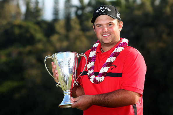 Patrick Reed celebrates after draining the winning putt to defeat Jimmy Walker in a playoff. Photo by Mike Ehrmann/Getty Images.