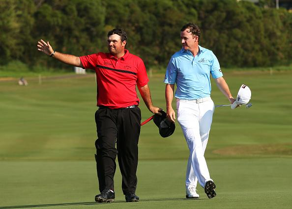 Patrick Reed and Jimmy Walker share a moment down the 18th fairway Monday. Reed defeated Walker in a playoff to win the Hyundai Tournament of Champions. Photo by Mike Ehrmann/Getty Images.