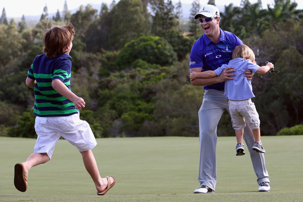 Zach Johnson celebrates with his sons, Will (L) and Wyatt (R), after winning the 2014 Hyundai Tournament of Champions at the Plantation Course at Kapalua Golf Club. Photo by Tom Pennington/Getty Images North America.
