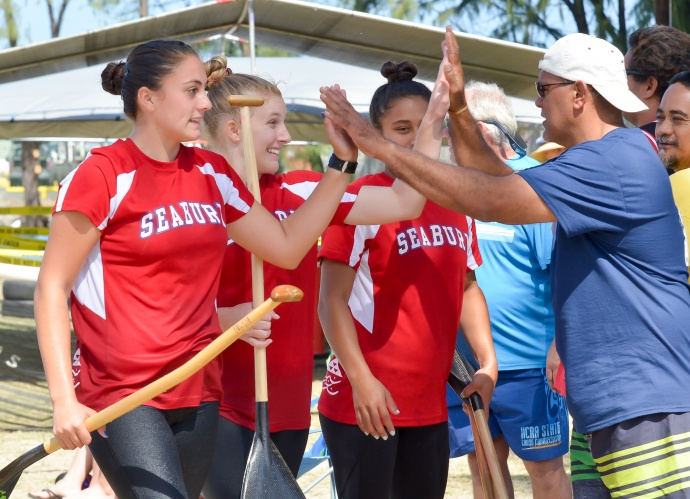 Seabury Hall girls are congratulated after their race Saturday. Photo by Rodney S. Yap.