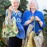 Marylou Melinger (left) , one of the founders of A Cup of Cold Water, received 10 new bags from Joy Webster, owner of Bag of Joy. Courtesy photo.