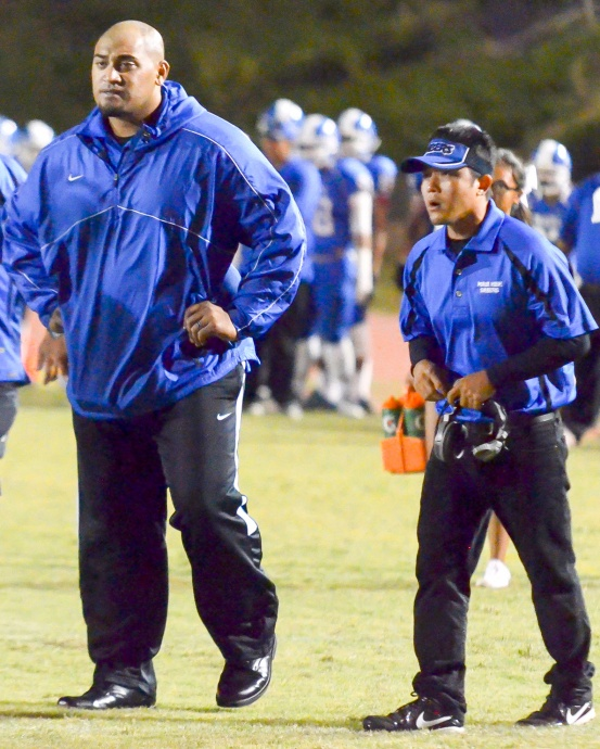Maui High head football coach David Bui (right) stepped down Tuesday, citing family reasons for his decision. Bui is shown with assistant coach Kamaloni Vainikolo in the Sabers' 2014 season-ending game against Lahainaluna. Photo by Rodney S. Yap.