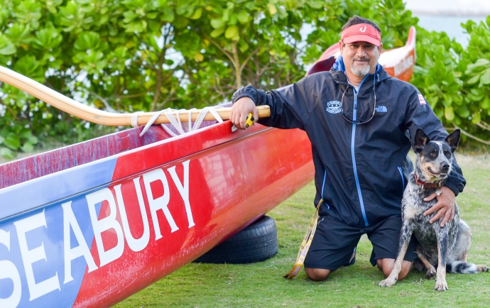 Seabury Hall head coach Paul Lu'uwai poses next to the Spartans' outrigger canoe with his dog, Hokule'a, in front the Hawaiian Canoe Club hale at Kahului Harbor Thursday afternoon. Photo by Rodney S. Yap.