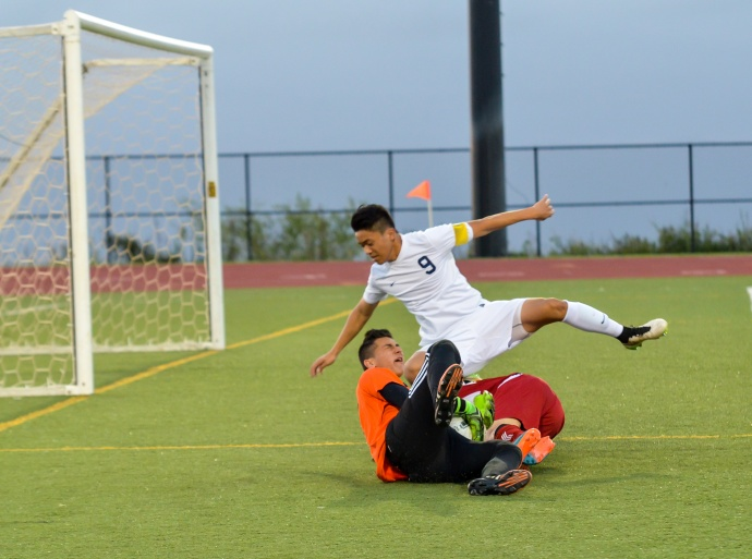 Kamehameha Maui's Bryant Kubo (9) and goalie Keola Paredes shut down a breakaway by Kalani's Takahiro Kosins during first-half action Saturday. Photo by Rodney S. Yap.