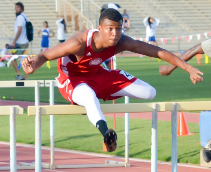 Lahainaluna's Emerson Liburd en route to winning the boys 110-meter high hurdles in 14.71 seconds Friday at War Memorial Stadium. Photo by Rodney S. Yap.