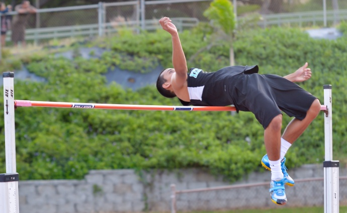 King Kekaulike's Corry Brown won the boys high jump by clearing 6 feet. Photo by Rodney S. Yap.