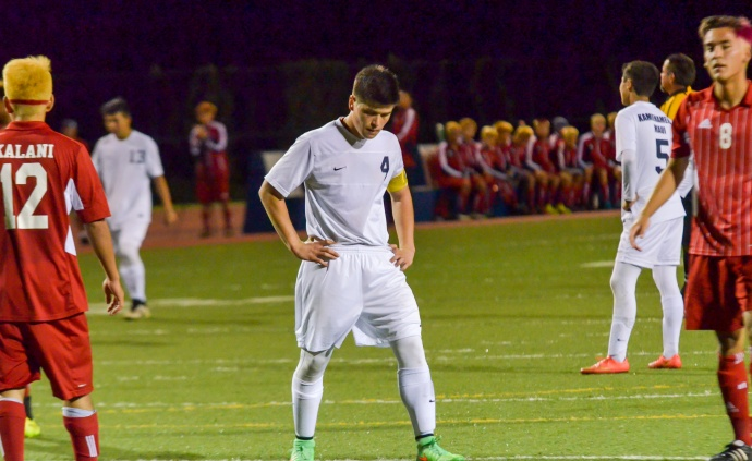 A frustrated Kamehameha Maui's Micah Alo (4) in the final minutes of the Warriors' 2-1 loss to Kalani Saturday in Puklani. Photo by Rodney S. Yap.