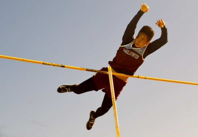 Baldwin High School's Kainoa Tom clears 15 feet on this attempt Friday at War Memorial Stadium. Photo by Rodney S. Yap.
