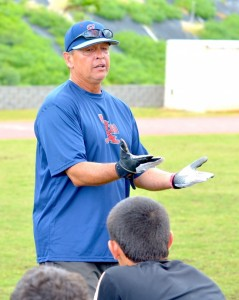 Quarterback coach Vince Passas at last year's free clinic on Maui. File photo by Rodney S. Yap.