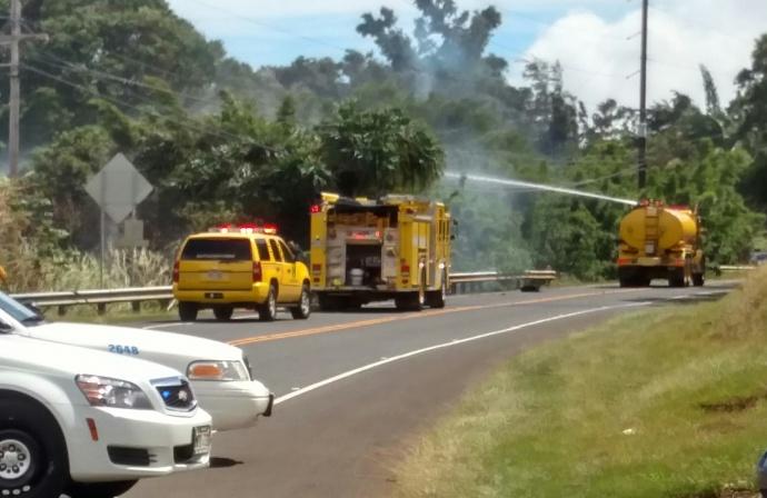 Fire along the Hāna Highway at Holokai Road.  Valentine's Day storm damage Maui, 2/14/15. Photo credit: John Korpi.