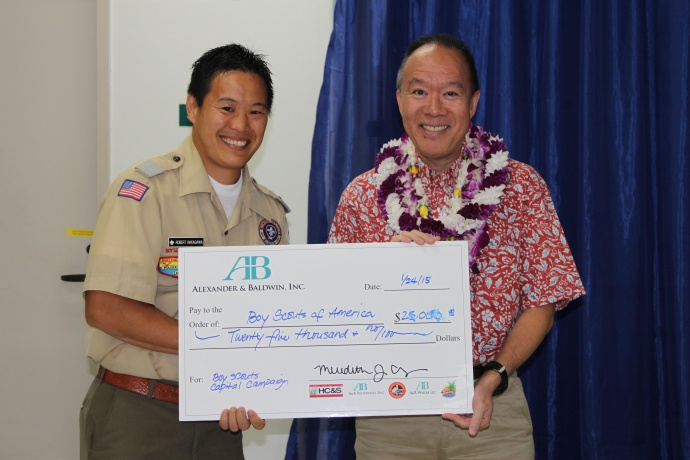 Newly Elected President Grant Chun (right) of A&B Properties presents a $25,000 donation check to Scout Executive Robert Nakagawa (left) for the Camp Maluhia Capital Campaign. Courtesy photo.