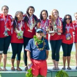 Seabury Hall girls and head coach Paul Kauhane Lu'uwai wear their silver medals proud Saturday after finishing second to Punahou at the state outrigger canoe championships at Kahului Harbor. Photo by Rodney S. Yap.