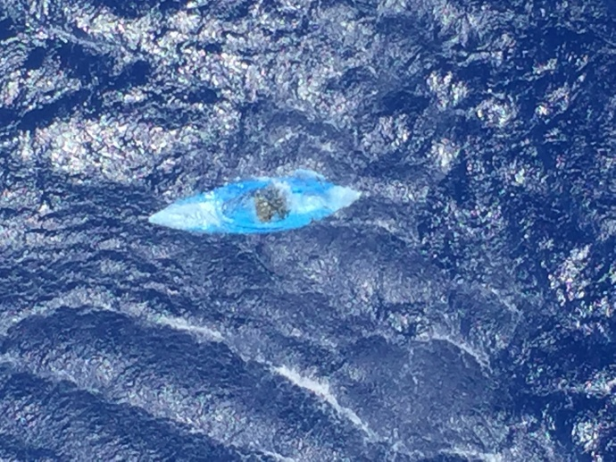 An unmanned and adrift kayak was discovered by an MH-65 Dolphin helicopter crew approximately 12 miles southwest of La'au Point, Molokai, March 29, 2015. There were no contents aboard, no discernible markings and no signs of distress in the immediate area. (Coast Guard courtesy photo)