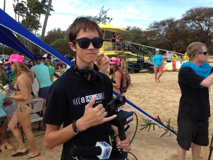 YBEAM graduate Colin McGee on location at Baldwin Beach Park for the Maui Butterfly SUP Event. Photo credit: YBEAM.