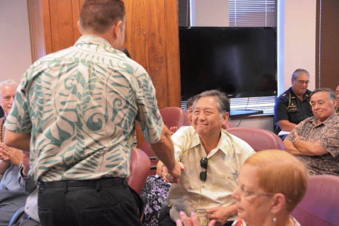 Budget Chair Hokama receives budget from Director Sandy Baz. Photo courtesy County of Maui, Office of the Mayor.