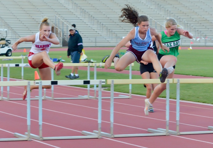 Baldwin High's Kaitlin Smith shows her winning form in the girls 100 hurdles, Smith also won the 300 hurdles, the long jump and the triple jump. Photo by Rodney S. Yap.