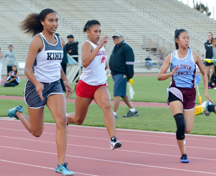 Kihei Charter's Maya Reynolds won the 100, 200, and 400 Saturday at the finals of the Yamamoto Invitational. Photo by Rodney S. Yap.