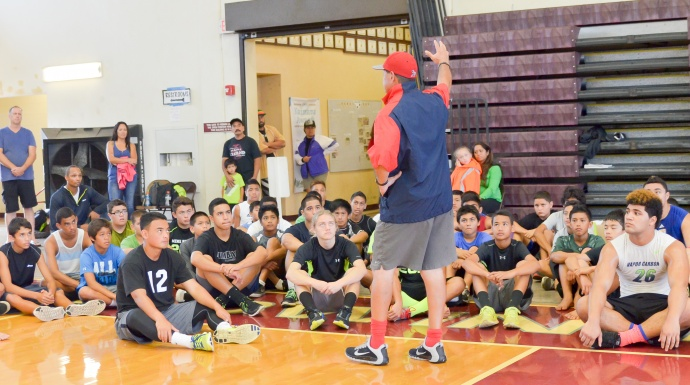 """Coach Vince Passas talks to more than 70 football athletes who attended Saturday free """"Get Better"""" Camp at Baldwin High School. Photo by Rodney S. Yap."""
