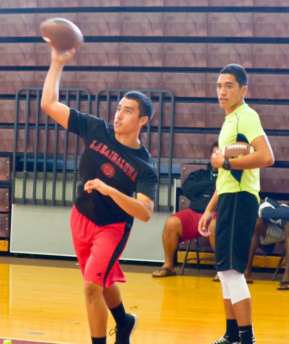 Lahainaluna sophomore quarterback Enele Scanlan throws the football as Molokai's John-Michael Mokiao-Duvachelle looks on Saturday at Baldwin High School Gym. Photo by Rodney S. Yap.