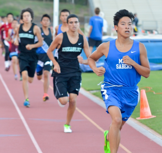 Maui High's Ryan Tsang leads the pack after the first lap of the boys 1,500-meter run Friday. Tsang won the race in 4:31.35. Photo by Rodney S. Yap.