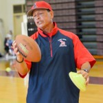 Saint Louis School's assistant coach Vince Passas explains the proper grip to throwing a football Saturday at Baldwin High School Gym, Photo by Rodney S. Yap.