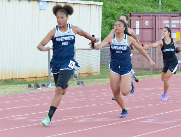 Kamehameha Maui's Selai Damuni hands the baton off to anchor runner Kimani Fernandez-Roy in the girls 4 x 100 relay Friday. Photo by Rodney S. Yap.