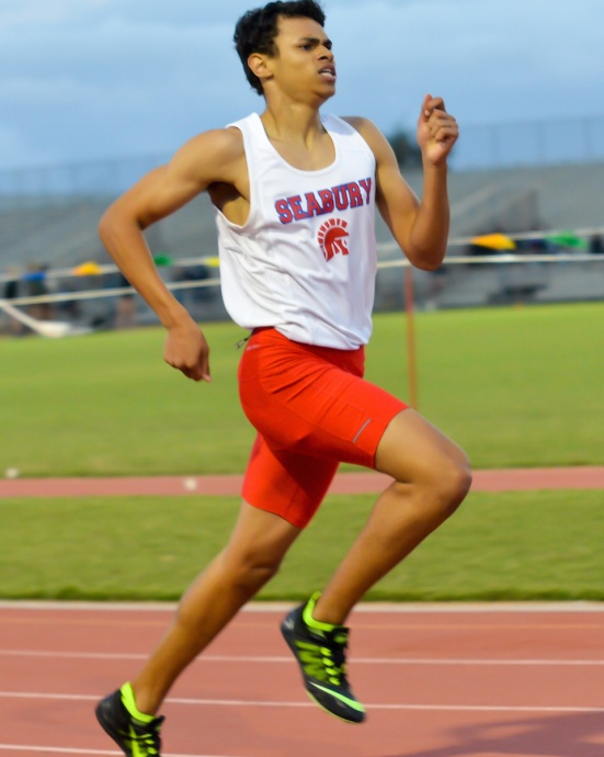 Seabury Hall freshman Isiah Payne won the boys 400 meters in 54.34 seconds. Photo by Rodney S. Yap.