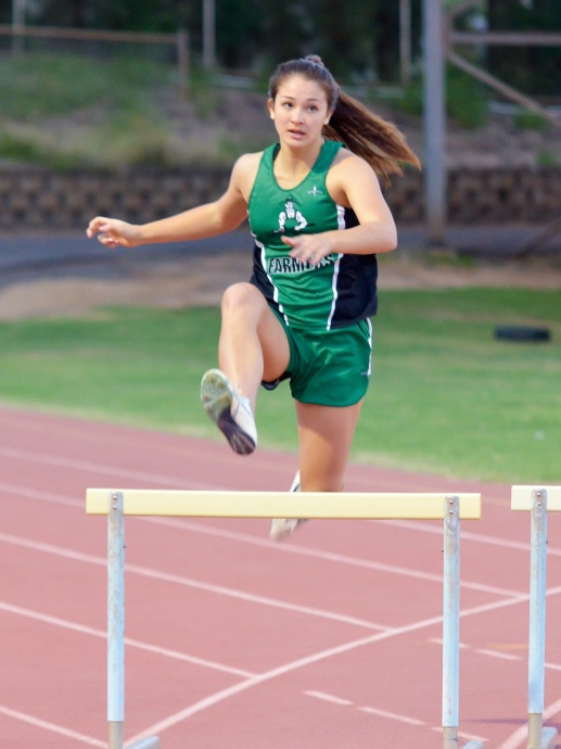 Molokai hurdler Alex Simon won the girls 300 hurdles in her first meet of the season. Simon was timed in 50.90 seconds. Photo by Rodney S. Yap.