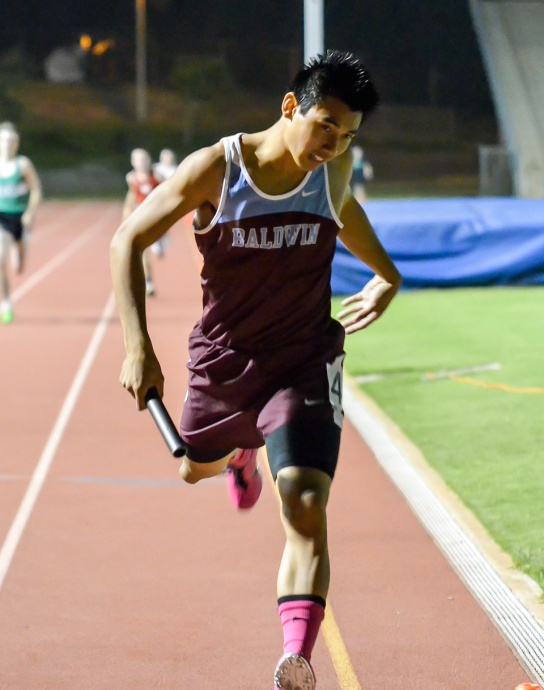 Baldwin's Bailey Kaopuiki won the boys 100 and 200, and anchored both the Bears' 4 x 100 and 4 x 400 relay teams in Saturday's finals of the Yamamoto Invitational. Photo by Rodney S. Yap.